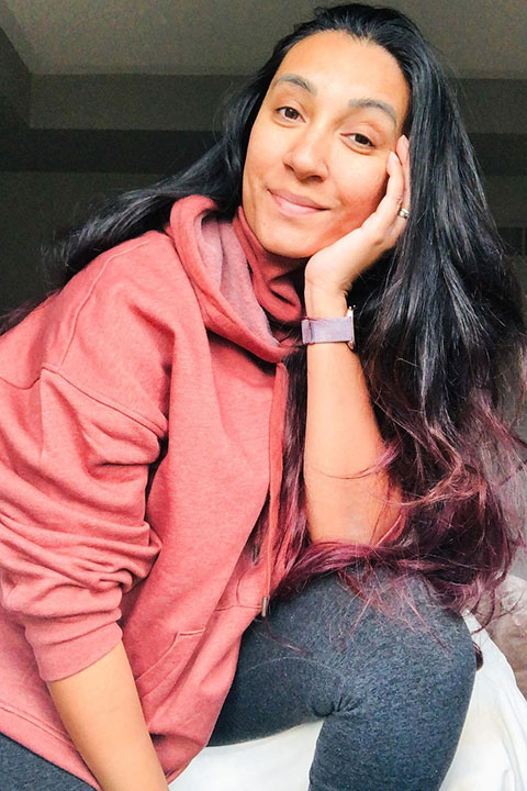 Tina Singh in pink hoodie and blue jeans