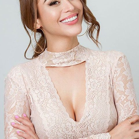Yanet Garcia is smiling and looking stunning in skin dress.