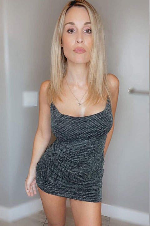 Allie Rae is looking hot in grey dress and her open hair are looking beautiful.